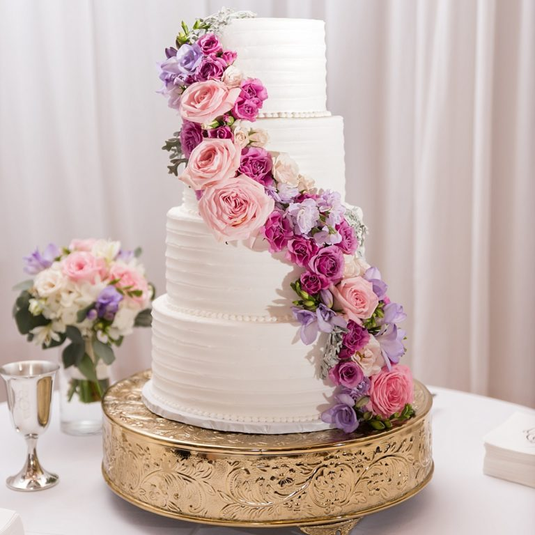 Beautiful, customized wedding cake with floral accents